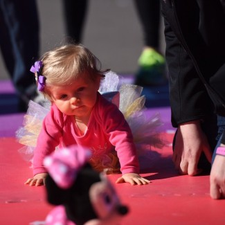 "Kenzie chasing after her ""coach"" at the Princess Half Marathon Weekend Diaper Dash"