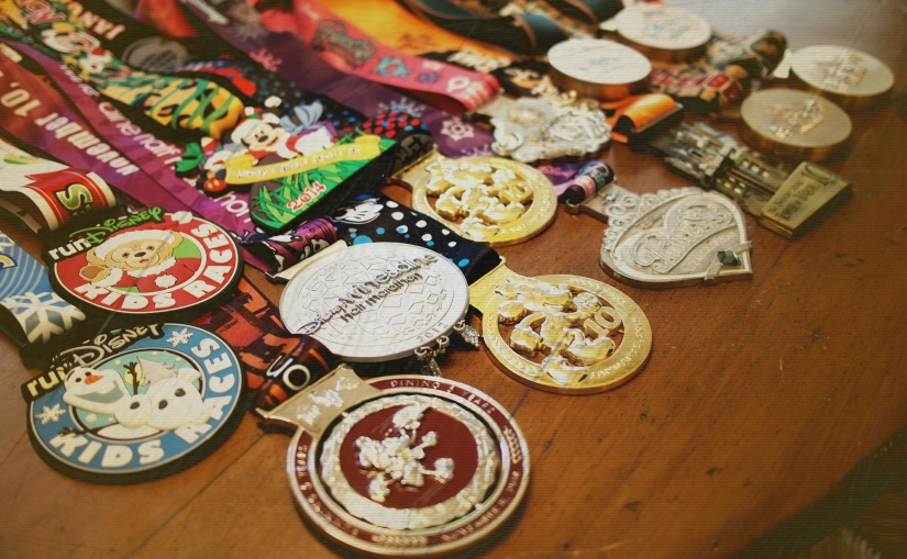 All of our runDisney medals, minus one.